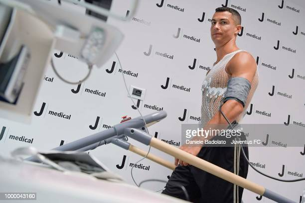 Juventus supporters wait for Cristiano Ronaldo who makes medical checks at the Juventus medical center in Turin Italy on July 16 2018