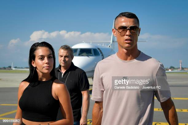 Juventus new signing Cristiano Ronaldo is seen upon his arrival at Caselle Airport along with Georgina Rodriguez on July 16 2018 in Turin Italy