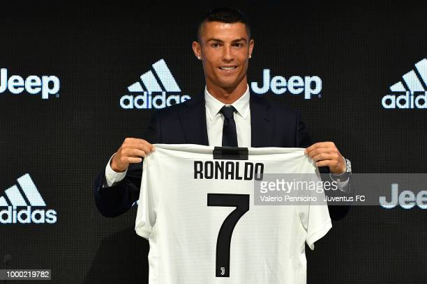 Juventus new signing Cristiano Ronaldo poses for the media during the press conference on July 16, 2018 in Turin, Italy.