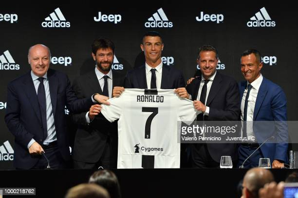 Juventus new signing Cristiano Ronaldo poses for the media with Giuseppe Marotta Andrea Agnelli Fabio Paratici and Jorge Mendes during the press...
