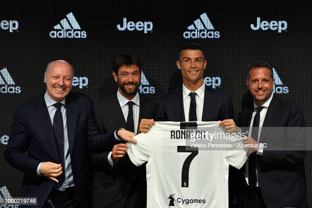 Juventus new signing Cristiano Ronaldo poses for the media with Giuseppe Marotta Andrea Agnelli Fabio Paratici during the press conference on July 16...