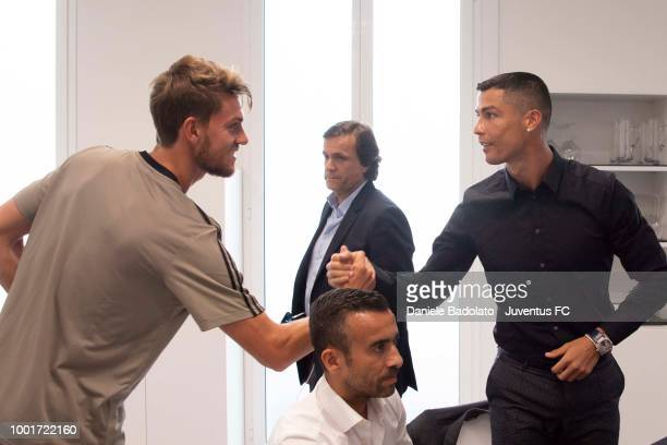 Juventus new signing Cristiano Ronaldo shakes hands with team mate Daniele Rugani on July 16 2018 in Turin Italy