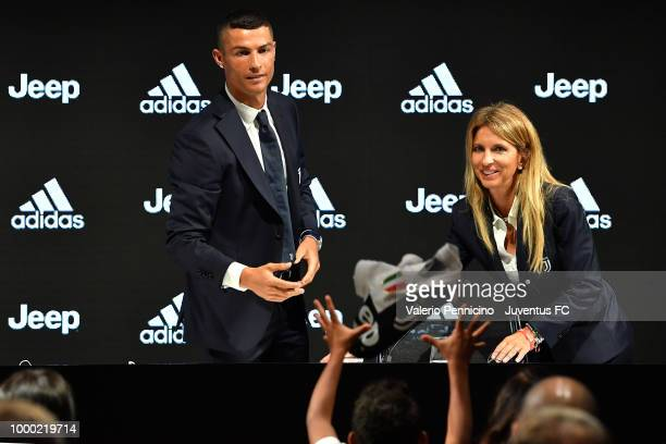 Juventus new signing Cristiano Ronaldo throws his new tshirt as a present to the media during the press conference on July 16 2018 in Turin Italy