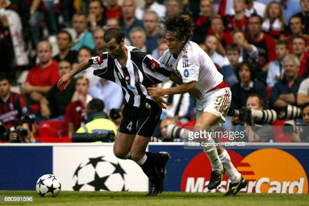 Juventus' Paolo Montero and AC Milan's Filippo Inzaghi battle for the ball