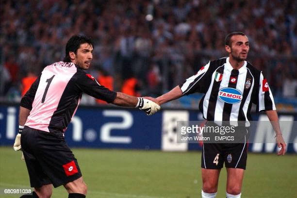 Juventus' Paolo Montero congratulates goalkeeper Gianluigi Buffon on saving the penalty which he conceided