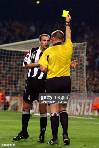 Juventus' Paolo Montero is shown the yellow card by referee Graham Poll