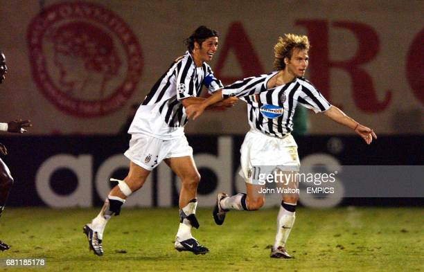 Juventus' Pavel Nedved is congratulated on scoring by his captain Alessio Tacchinardi