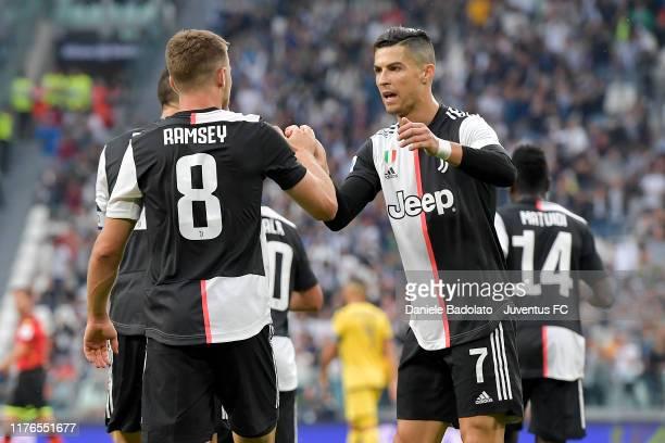 Juventus player Aaron Ramsey celebrates 11 goal with Cristiano Ronaldo during the Serie A match between Juventus and Hellas Verona at Allianz Stadium...