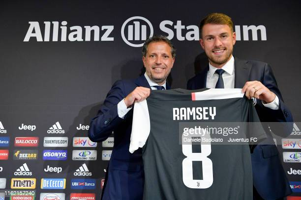 Juventus player Aaron Ramsey with Fabio Paratici during a press conference at Allianz Stadium on July 15, 2019 in Turin, Italy.