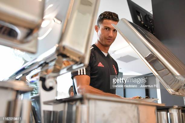 Juventus player Cristiano Ronaldo looks on during the lunch at J Hotel on July 14 2019 in Turin Italy