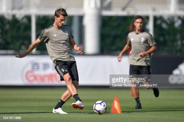 Juventus player Daniele Rugani kicks the ball during a training session at JTC on September 27 2018 in Turin Italy