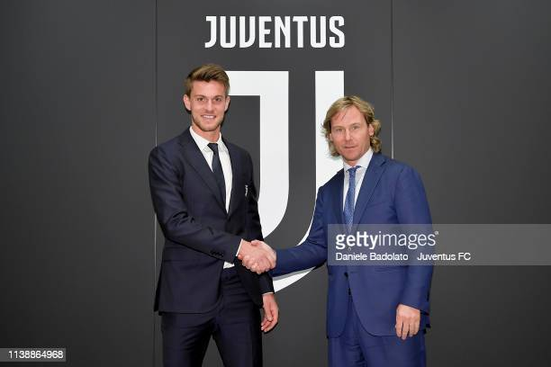 Juventus player Daniele Rugani, pictured with Pavel Nedved, extends his contract with Juventus at Juventus headquarters on March 28, 2019 in Turin,...