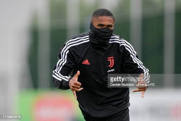 Juventus player Douglas Costa during a training session at JTC on September 10 2019 in Turin Italy