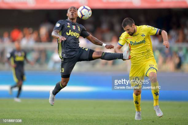 Juventus player Douglas Costa during the serie A match between Chievo Verona and Juventus at Stadio Marc'Antonio Bentegodi on August 18 2018 in...