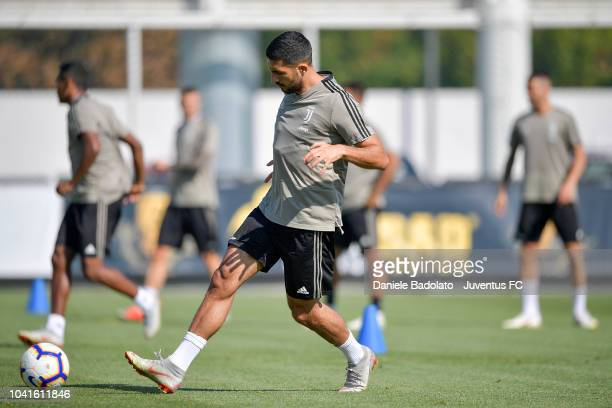 Juventus player Emre Can kicks the ball during a training session at JTC on September 27 2018 in Turin Italy