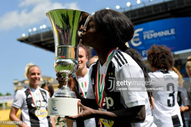 Juventus player Eniola Aluko celebrates with the trophy after the Women Coppa Italia Final match between Juventus Women and ACF Fiorentina Stadio...