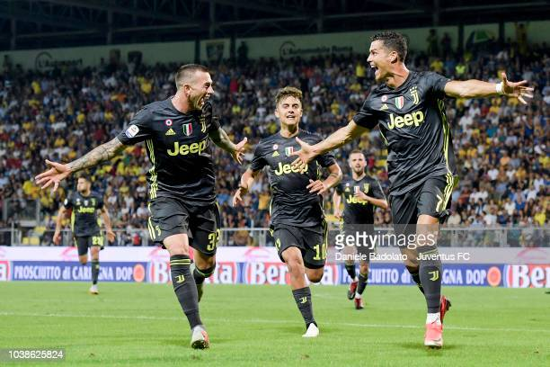 Juventus player Federico Bernardeschi celebrates with teammate Cristiano Ronaldo after scoring a goal to make it 02 during the serie A match between...