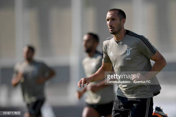 Juventus player Giorgio Chiellini warms up during a training session at JTC on August 14 2018 in Turin Italy