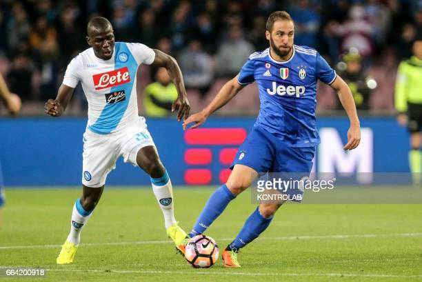 Juventus' player Gonzalo Higuain vies with Napoli's player Kalidou Koulibaly during the Italian Serie A football match between SSC Napoli and FC...