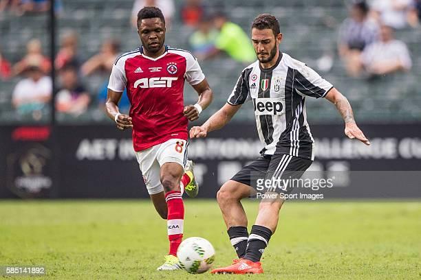 Juventus' player Grigoris Kastanos battles South China's player Mahama Awai for the ball during the South China vs Juventus match of the AET...