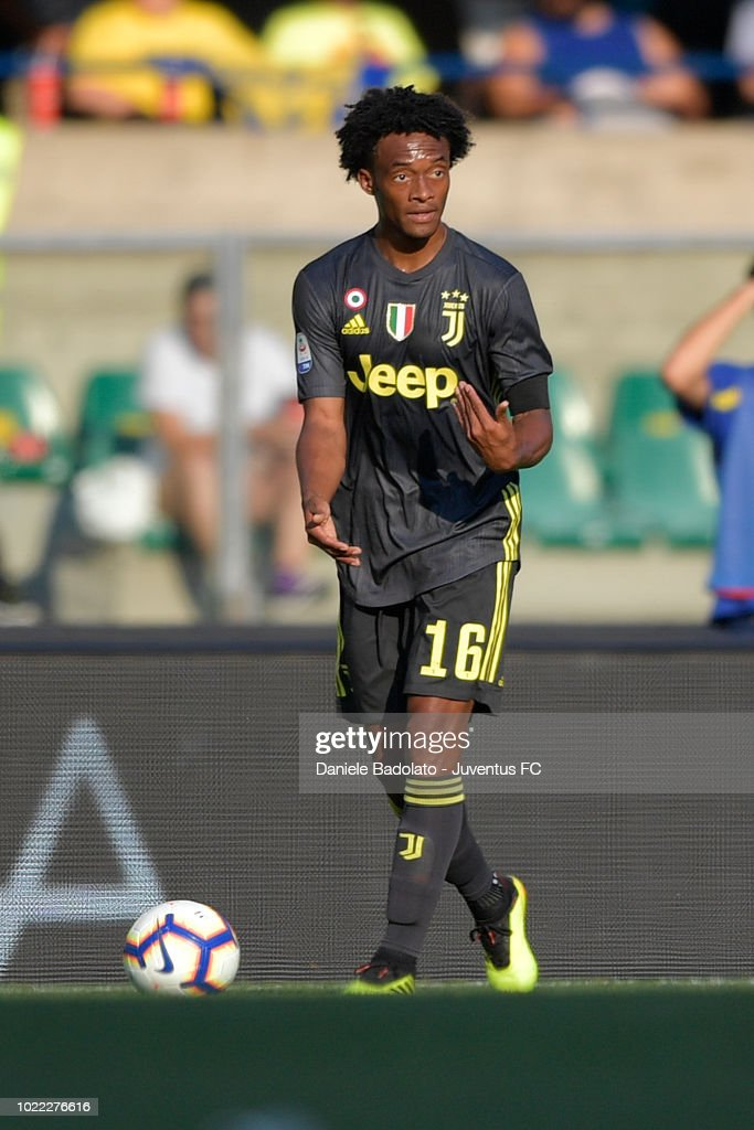 Juventus player Juan Cuadrado in action during the serie A match between Chievo Verona and Juventus at Stadio Marc'Antonio Bentegodi on August 18, 2018 in Verona, Italy.