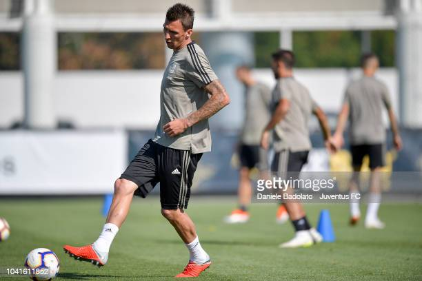 Juventus player Mario Mandzukic kicks the ball during a training session at JTC on September 27 2018 in Turin Italy