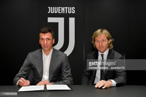 Juventus player Mario Mandzukic , pictured with Pavel Nedved, extends his contract with Juventus at Juventus headquarters on April 04, 2019 in Turin,...