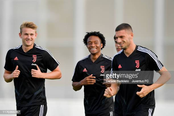 Juventus player Matthijs de Ligt Juan Cuadrado and Merih Demiral during a training session at JTC on August 26 2019 in Turin Italy