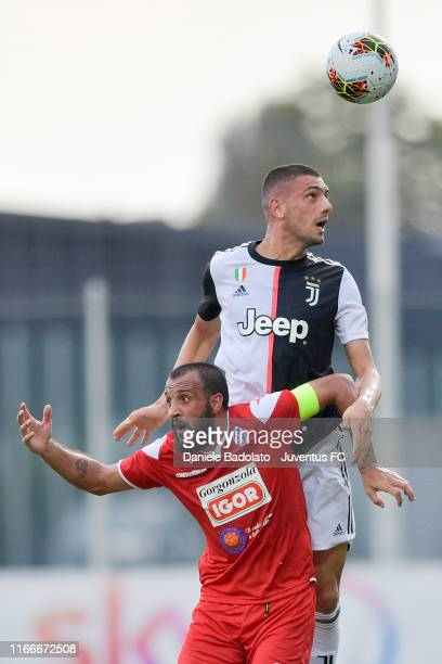 Juventus player Merih Demiral heads the ball during a training session with Novara at JTC on August 07 2019 in Turin Italy