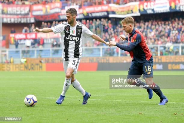 Juventus player Miralem Pjanic and Genoa player Esteban Rolon during the Serie A match between Genoa CFC and Juventus at Stadio Luigi Ferraris on...