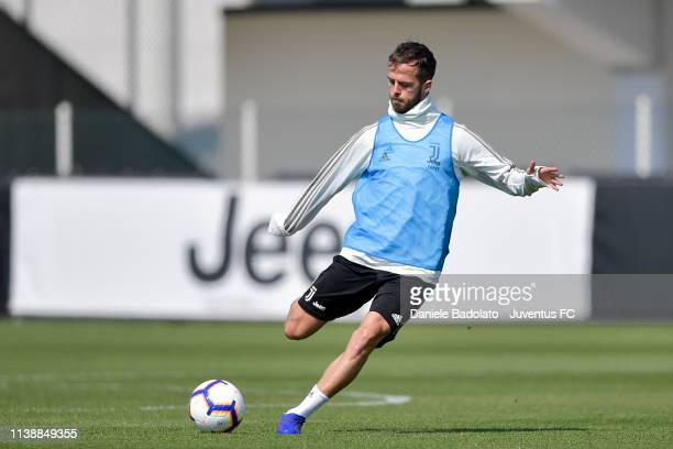 Juventus player Miralem Pjanic kicks the ball during a training session at JTC on March 28 2019 in Turin Italy