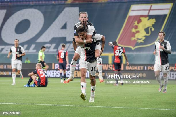 Juventus player Paulo Dybala celebrates after scoring the 01 goal with Miralem Pjanic during the Serie A match between Genoa CFC and Juventus at...