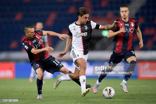 Juventus player Paulo Dybala controls the ball during the Serie A match between Bologna FC and Juventus at Stadio Renato Dall'Ara on June 22, 2020 in...