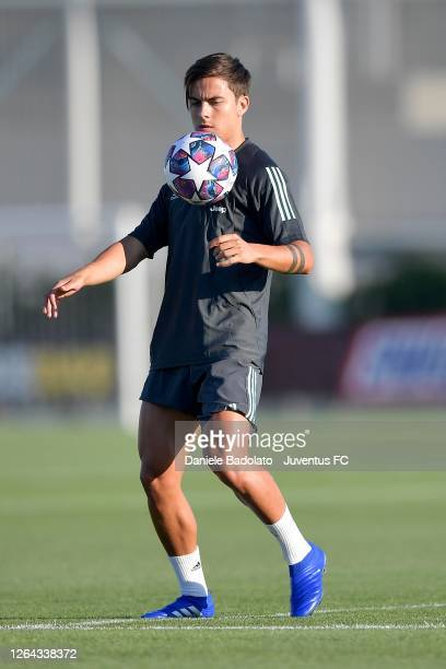 Juventus player Paulo Dybala during a Champions League training session ahead of the match between Juventus and Olympique Lyonnais at JTC on August...