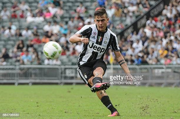 Juventus player Paulo Dybala kicks the ball during the football match between Juventus and South China at Hong Kong Stadium on July 30 2016 / AFP /...