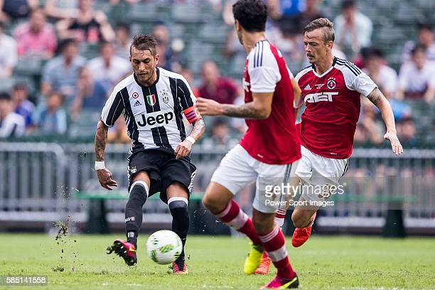 Juventus' player Roberto Pereyra contests the ball against South China's player Griffiths Ryan Alan during the South China vs Juventus match of the...