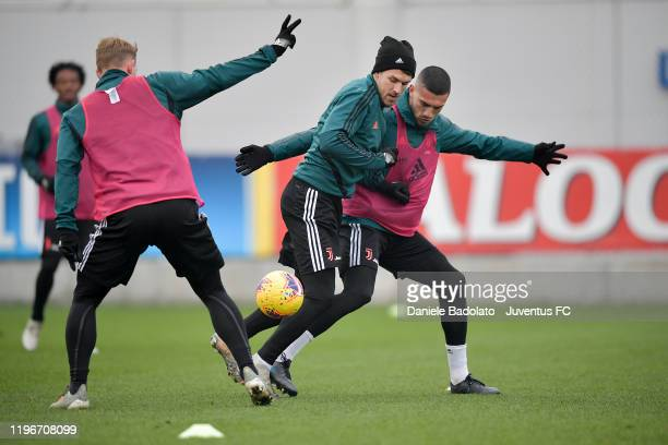Juventus players Aaron Ramsey and Merih Demiral during a training session at JTC on December 30 2019 in Turin Italy