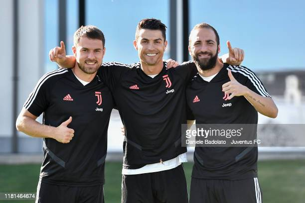 Juventus players Aaron Ramsey Cristiano Ronaldo and Gonzalo Higuain during a training session at JTC on October 16 2019 in Turin Italy
