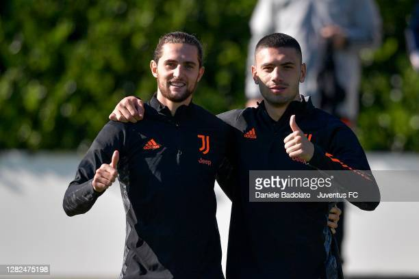 Juventus players Adrien Rabiot and Merih Demiral during the UEFA Champions League training session at JTC on October 27 2020 in Turin Italy