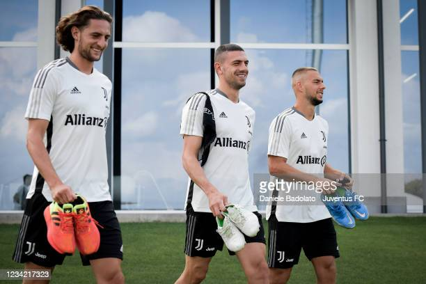 Juventus players Adrien Rabiot, Merih Demiral, Marko Pjaca during a training session at Jtc on July 26, 2021 in Turin, Italy.