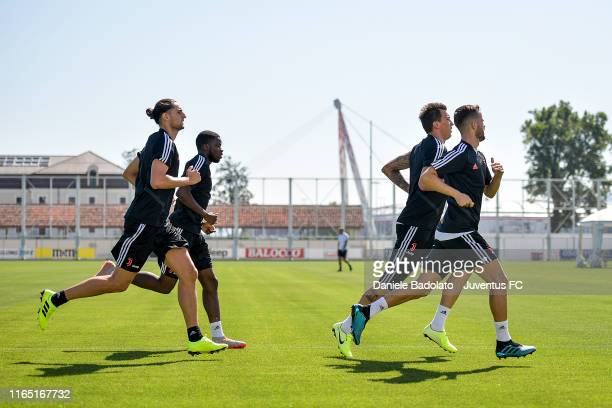 Juventus players Adrien Rabiot Stephy Mavididi Mario Mandzukic and Miralem Pjanic in action during a training session at JTC on July 23 2019 in Turin...