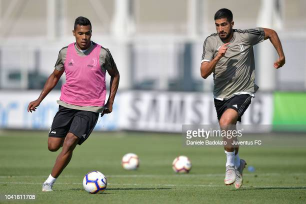 Juventus players Alex Sandro and Emre Can during a training session at JTC on September 27 2018 in Turin Italy