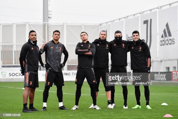 Juventus players Alex Sandro, Danilo, Cristiano Ronaldo, Leonardo Bonucci, Merih Demiral and Alvaro Morata during a training session ahead of the...
