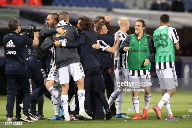 Juventus players and staff celebrate following the results from other games confirming the club's qualficiation for the Champions League during the...