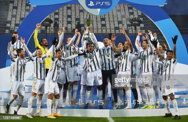 Juventus players and Staff celebrate with the PS5 Supercup following their side's victory after the Italian PS5 Supercup match between Juventus and...