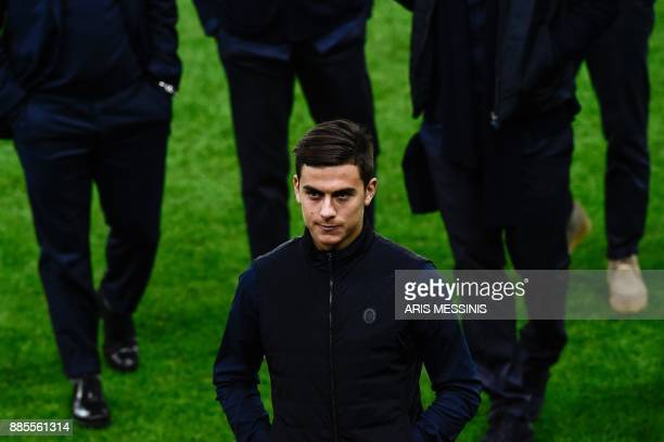 FC Juventus' players attend a walkaround at Karaiskakis Stadium in Piraeus port near Athens on December 4 on the eve of the team's UEFA Champions...