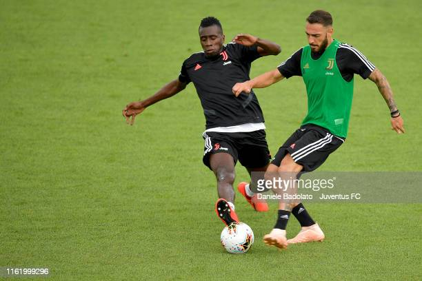Juventus players Blaise Matuidi and Grigoris Kastanos competes for the ball during the training session at Jtc on July 14, 2019 in Turin, Italy.