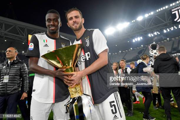 Juventus players Blaise Matuidi and Miralem Pjanic during the Serie A match between Juventus and Atalanta BC on May 19 2019 in Turin Italy
