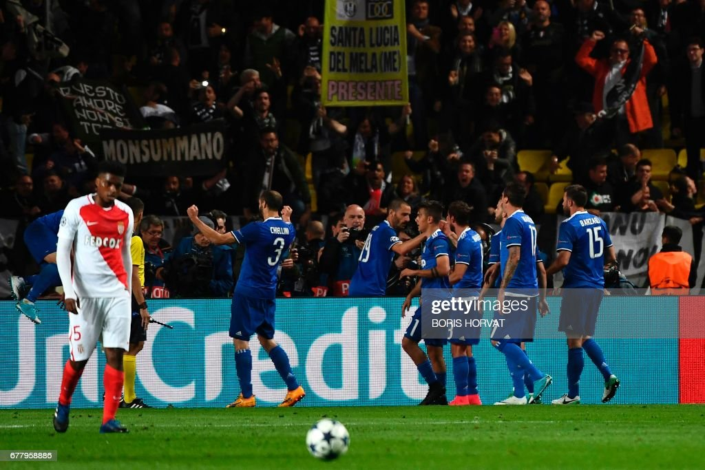 Juventus players celebrate a goal by forward from Argentina Gonzalo Higuain during the UEFA Champions League semi-final first leg football match Monaco vs Juventus at the Stade Louis II stadium in Monaco on May 3, 2017. /