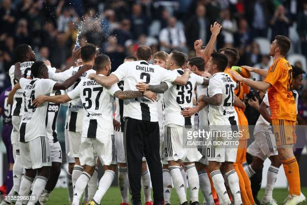 Juventus players celebrate after Juventus secured its 8th consecutive Italian 2018/19 Scudetto Serie A championships after winning the Italian Serie...